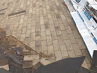 a damaged roof needing roof replacement