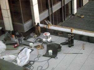 flat roof repair is being performed