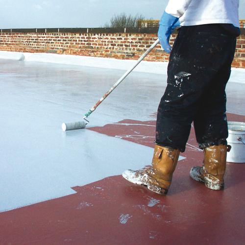 flat roof maintenance is being performed